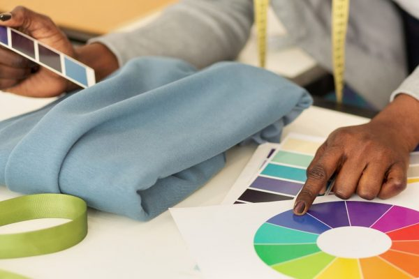 Female Designer Working With Fabric And Color Samples, Closeup